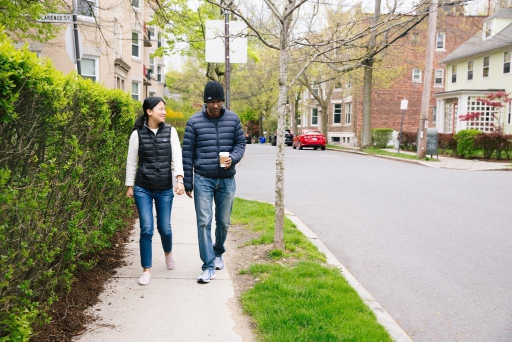 Cancer fighter and wife walking through Boston neighborhood