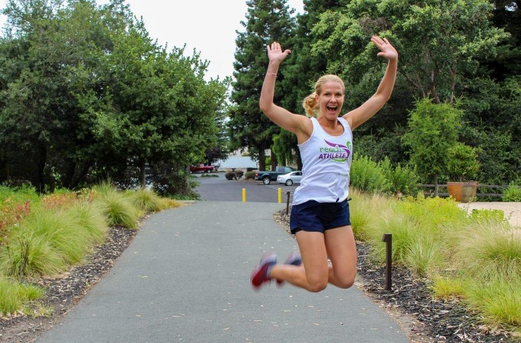 Reach Athlete jumping in air