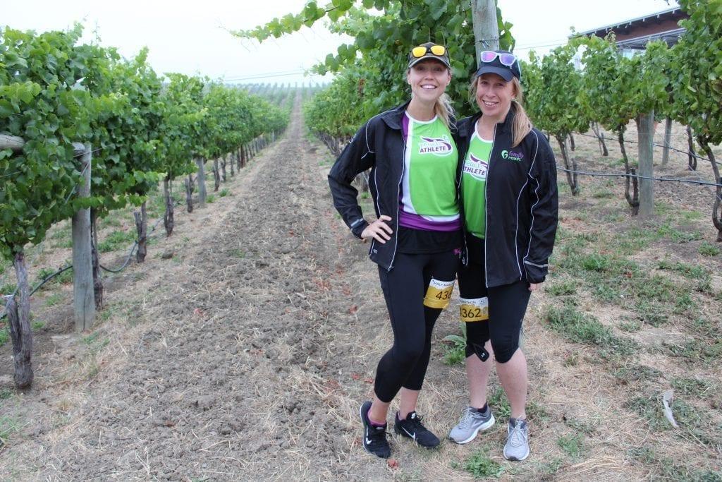 Reach Athletes standing in wine vineyard in Napa