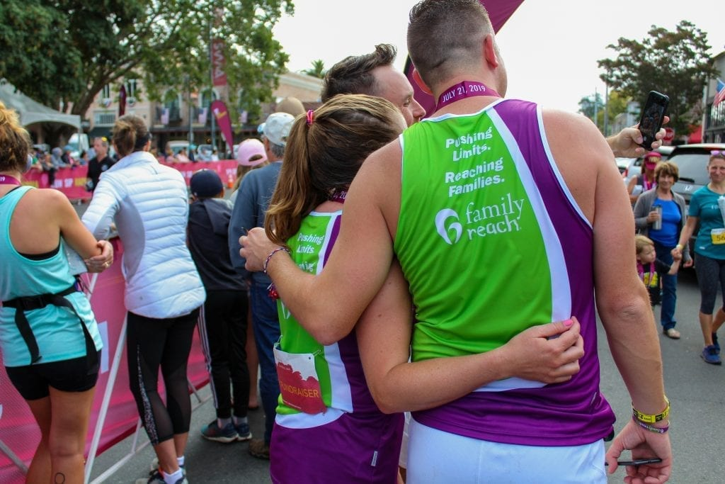 More members of the team sharing in the joy of crossing the finish line