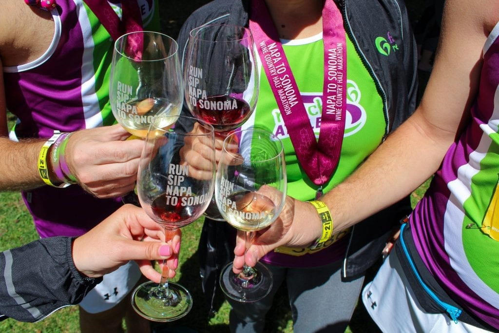 Wine glasses cheersing