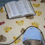 A bible is placed on the bed of a three-month old baby suffering from leukaemia at the paediatric cancer section of the Hospital Escuela in Tegucigalpa September 10, 2012. Doctors at the hospital dressed up as fantasy characters on  Monday to cheer up cancer-stricken children during Children's Day, celebrated in Honduras every September 10. REUTERS/Jorge Cabrera (HONDURAS - Tags: HEALTH SOCIETY) - RTR37SY7
