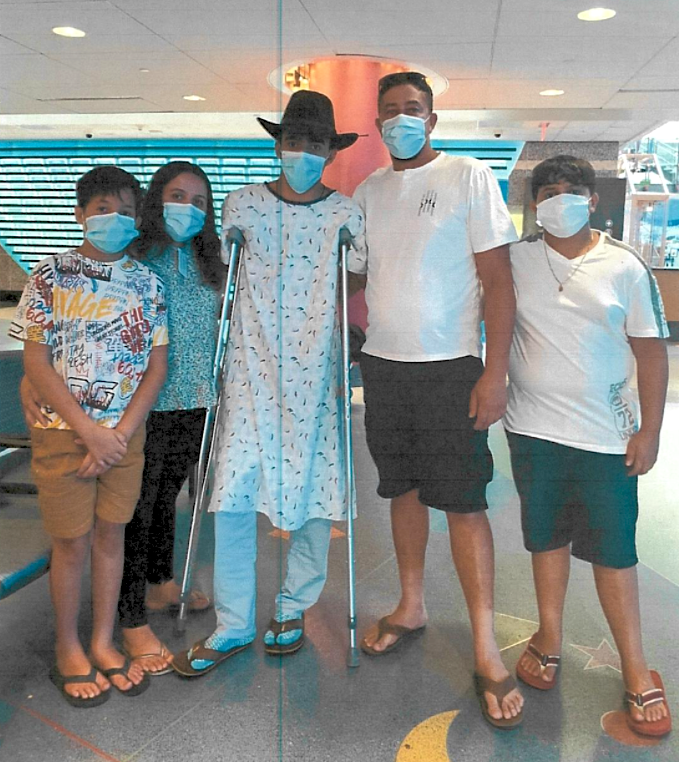 Cancer hero Erick with his family in the hospital