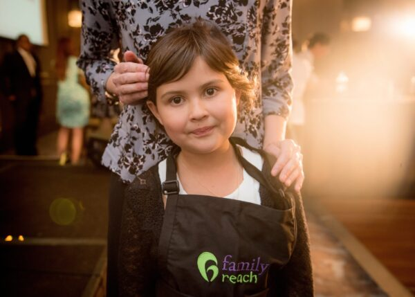 Larissa's daughter, Ella, at Family Reach's 2017 Cooking Live event in Boston.