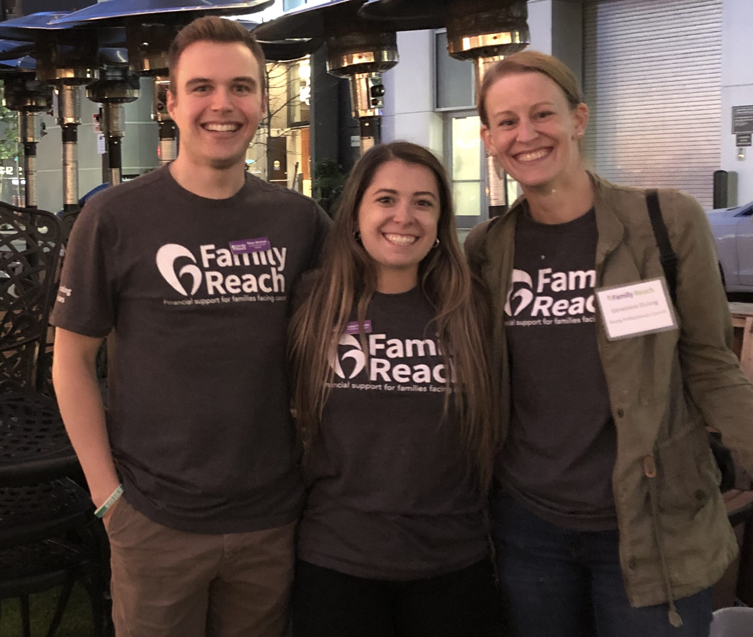 Young Professionals Council Member with Family Reach staff